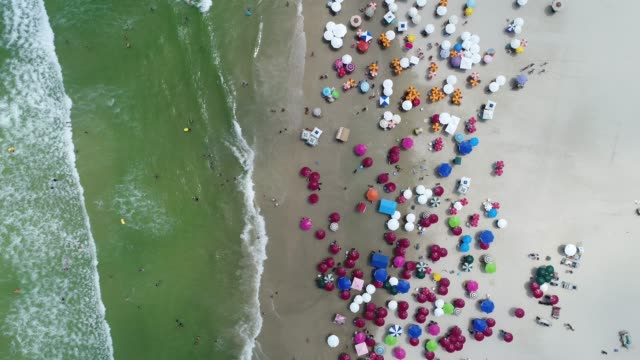 aerial view of guaruja beach in sao paulo, brazil - parasol stock videos & royalty-free footage