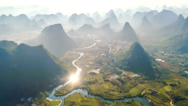vídeos de stock, filmes e b-roll de vista aérea de guilin - rice paddy