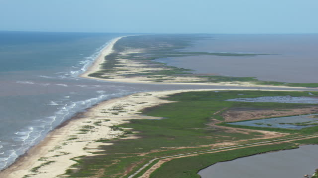 aerial view of gulf coast beach and river inlet near bay city, texas. - inlet stock videos & royalty-free footage