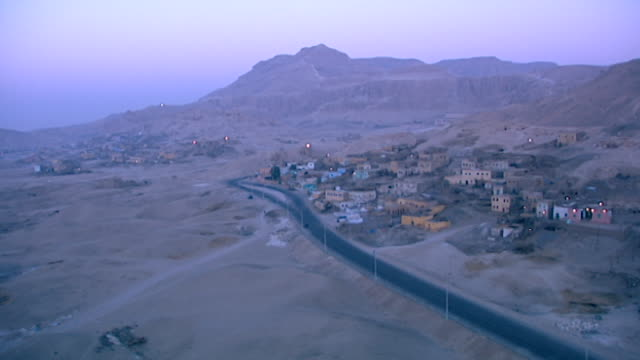 aerial view of gurneh village and deir el bahari at dawn. - tempio di hatshepsut video stock e b–roll