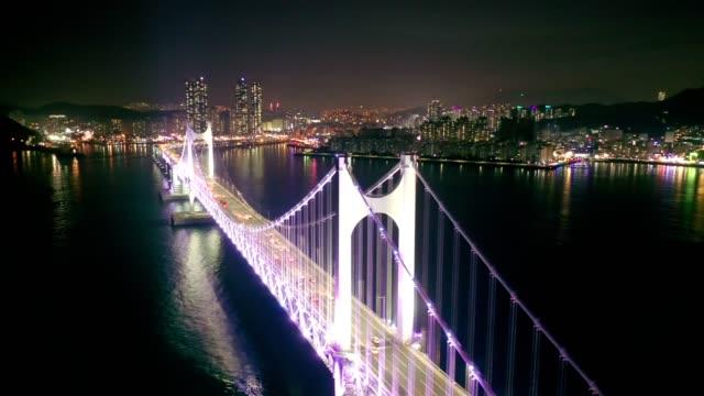 aerial view of gwangan bridge with busan city at night, south korea - busan stock videos & royalty-free footage