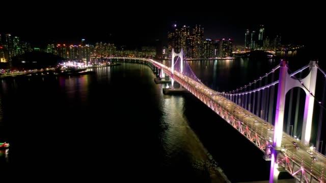aerial view of gwangan bridge with busan city at night - busan stock videos & royalty-free footage