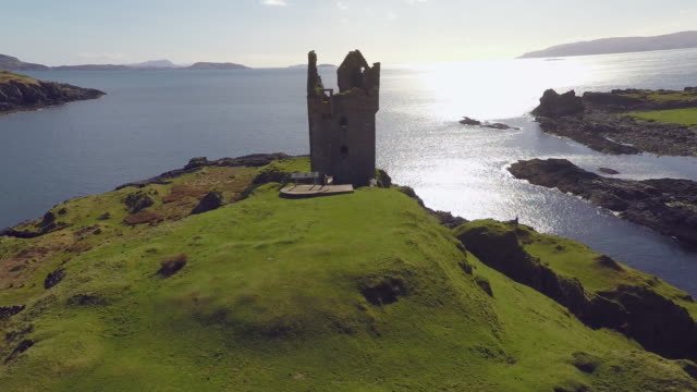 aerial view of gylen castle in kerrera scotland, with valley and coastline - scotland stock videos & royalty-free footage
