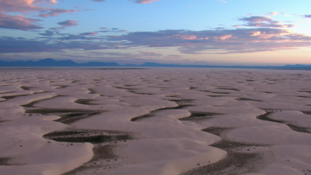 aerial view of gypsum sand dunes in white sands national park during dusk, new mexico, united states of america - natural pattern stock videos & royalty-free footage