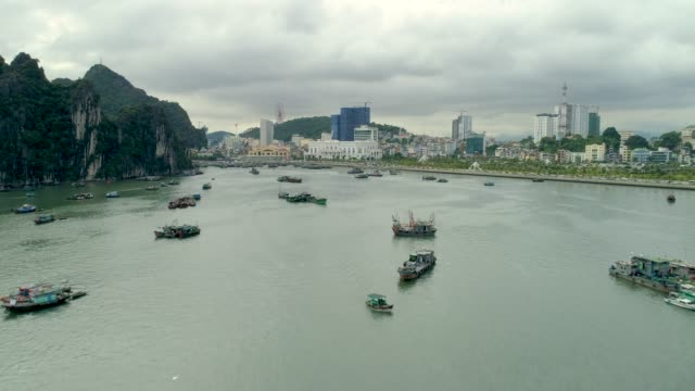 aerial view of ha long bay and halong city skyline - karst formation stock videos & royalty-free footage