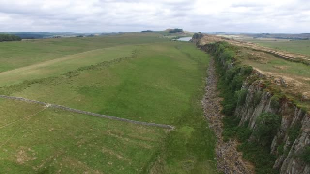 aerial view of hadrian's wall at steel rigg northumberland england uk - archaeology stock videos & royalty-free footage