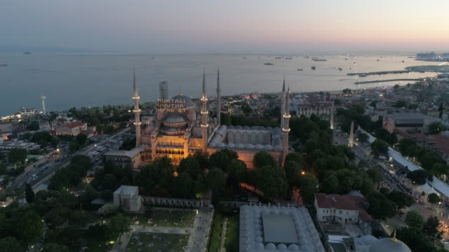 aerial view of hagia sophia and sultanahmet blue mosque at sunrise in istanbul - mosque stock videos & royalty-free footage