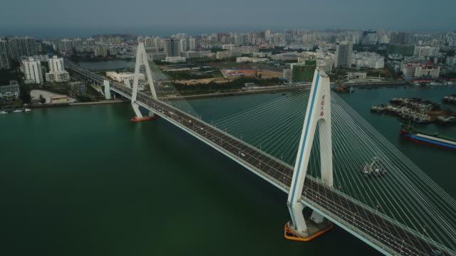 aerial view of haikou cityscape in hainan province, china - 不動産の看板点の映像素材/bロール