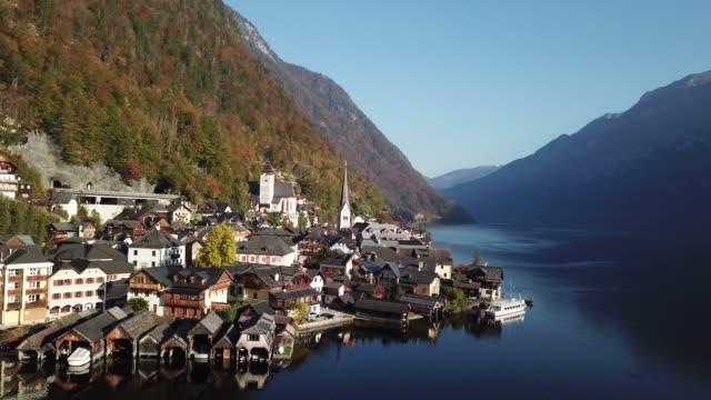 aerial view of hallstatt village and lake hallstatt with blue sky in austria. - dachstein mountains stock videos and b-roll footage