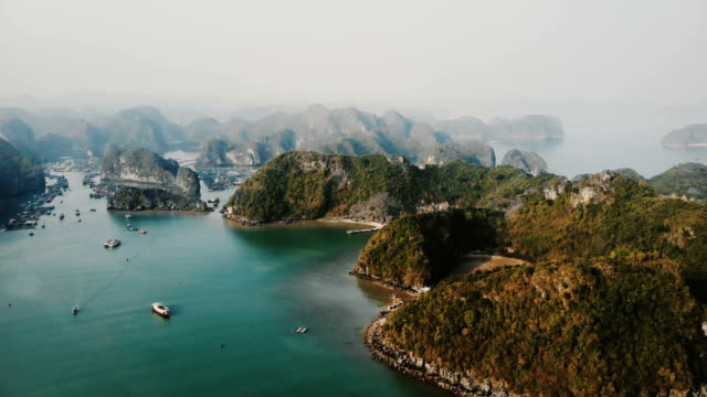 aerial view of halong bay in vietnam - televisione a ultra alta definizione video stock e b–roll