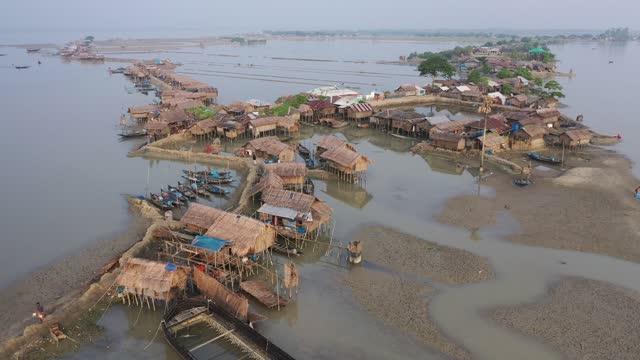 aerial view of hanging village in the coastal area of bangladesh on november 09, 2020. coastal village kalabogi at the bank of the river shibsha... - natural disaster stock videos & royalty-free footage