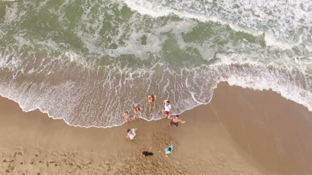 4K Aerial view of happy young people