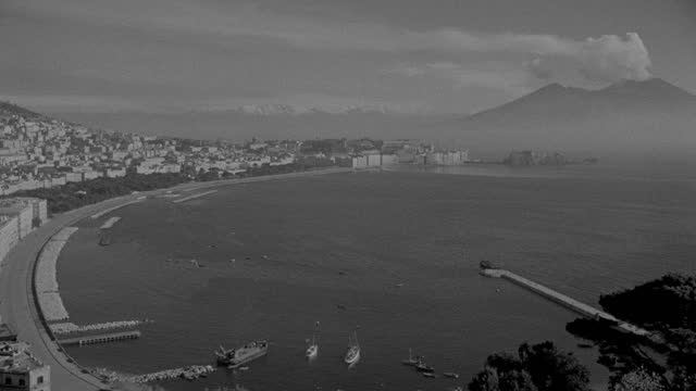 aerial view of harbor and city with mount vesuvius appears in the distance from naples, italy - 1936 stock videos & royalty-free footage