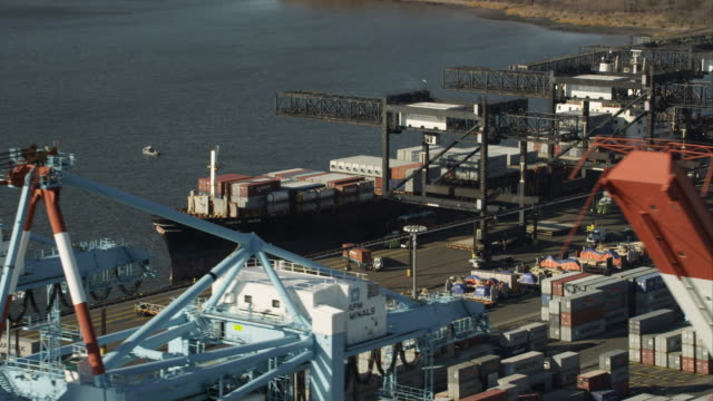 aerial view of harbor cranes and container ships at port elizabeth, new jersey. shot in 2011. - new jersey stock-videos und b-roll-filmmaterial