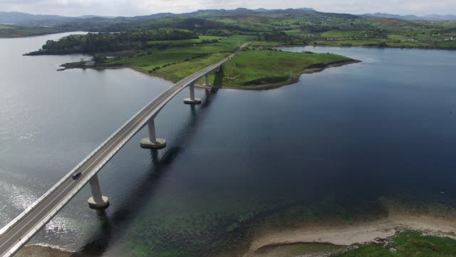 aerial view of harry blaney bridge. county donegal, ireland - 湾点の映像素材/bロール