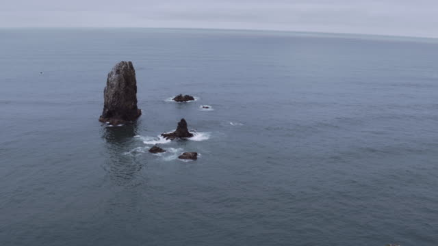 aerial view of haystack rocks in the ocean - oregon coast stock videos & royalty-free footage