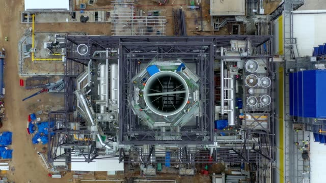 aerial view of heat recovery steam generator (hrsg), steel structure and stack of combined cycle power plant - generator stock videos & royalty-free footage