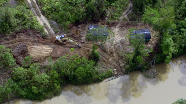 aerial view of heavy equipment digging at illegal gold mine, colombia - medellin colombia stock videos & royalty-free footage