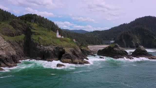 aerial view of heceta head lighthouse on the oregon coast - heceta head stock videos & royalty-free footage