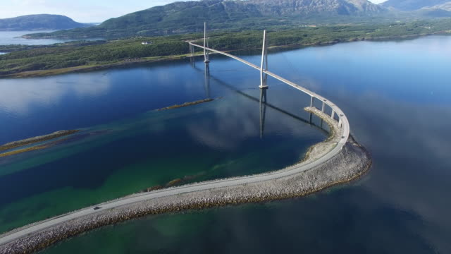 aerial view of helgeland bridge over  fjord near sandnessjoen in norway - cable stayed bridge stock videos & royalty-free footage