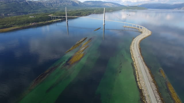 aerial view of helgeland bridge over  fjord near sandnessjoen in norway - country road stock videos & royalty-free footage