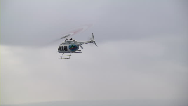 aerial view of helicopter in the clouds. - helicopter tour stock videos and b-roll footage