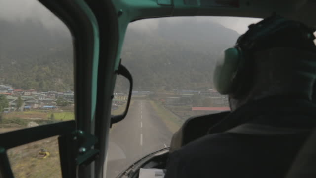 aerial view of helicopter landing, at airport - nepal stock-videos und b-roll-filmmaterial