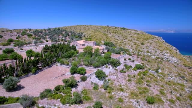 aerial view of hermitage of ermita de betlem in the mountains of artà ( serra artana or massís d'artà ) of balearic islands majorca / spain - 2010 2019 stock videos & royalty-free footage