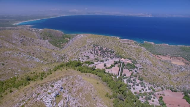 aerial view of hermitage of ermita de betlem in the mountains of artà ( serra artana or massís d'artà ) and bay of alcúdia - balearic islands majorca / spain - pilgrim stock videos & royalty-free footage