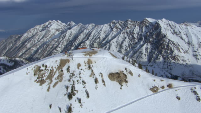 aerial view of hidden peak summit ski area and snowcapped wasatch range, salt lake county, utah, united states of america. - provo stock videos & royalty-free footage