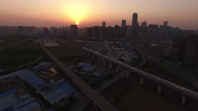 aerial view of high speed train and construction site - 高速列車点の映像素材/bロール