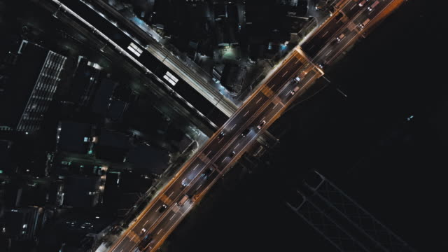 aerial view of highway across the city - liyao xie stock videos & royalty-free footage