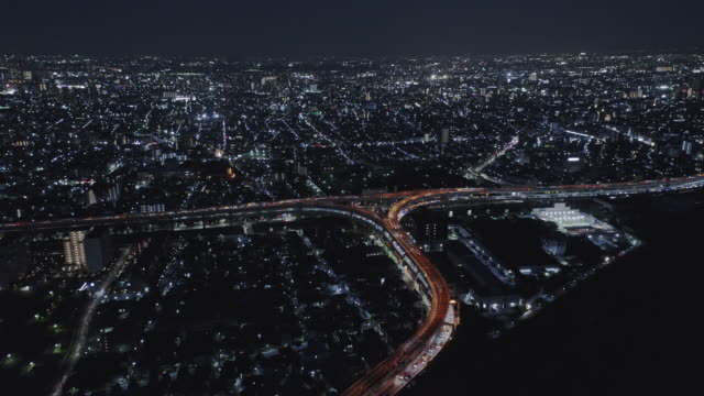 aerial view of highway across the residential district - liyao xie stock videos & royalty-free footage