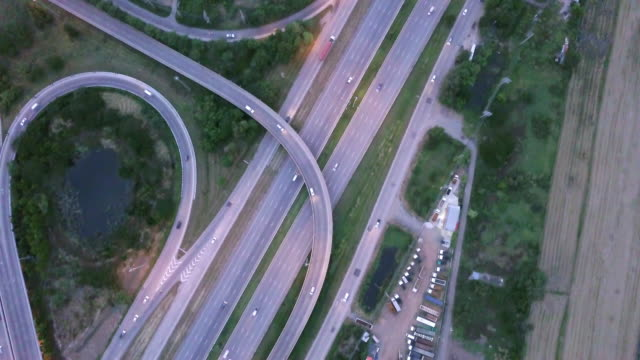 aerial view of highway crossroad rush hour traffic - autostrada a corsie multiple video stock e b–roll