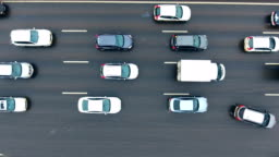 Aerial View of Highway Interchange. Cars on a overpass. 4K. Bird view.