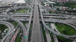 Aerial view of highway junction with traffic in Bangkok city, Thailand
