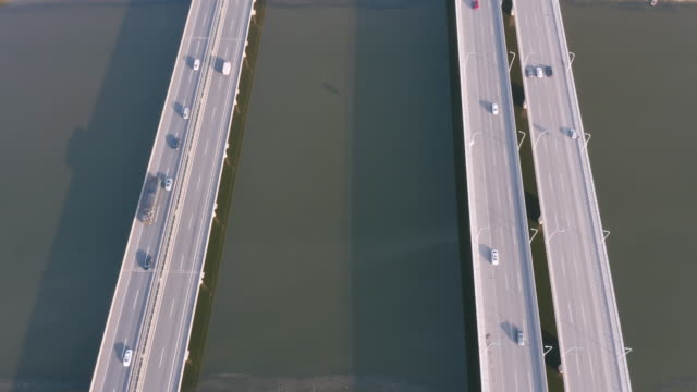 aerial view of highway over the river - liyao xie stock videos & royalty-free footage