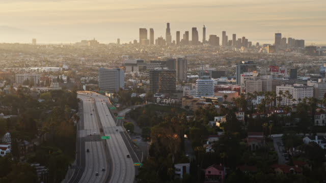 aerial view of hollywood and dtla at sunrise - echtzeit stock-videos und b-roll-filmmaterial