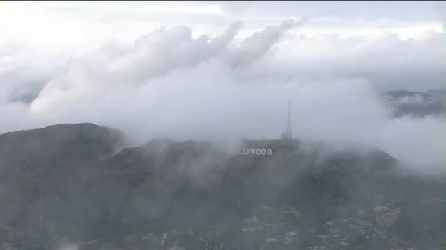 aerial view of hollywood sign on a cloudy and rainy day on april 7, 2015. close-up/wide shot of hollywood sign. - hollywood california stock videos & royalty-free footage