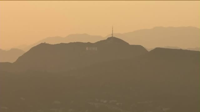 aerial view of hollywood sign the sun sets - hollywood california stock videos & royalty-free footage