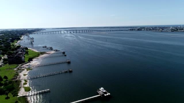 aerial view of homes along atlantic beach towards a bridge in north carolina - atlantic beach north carolina stock videos & royalty-free footage