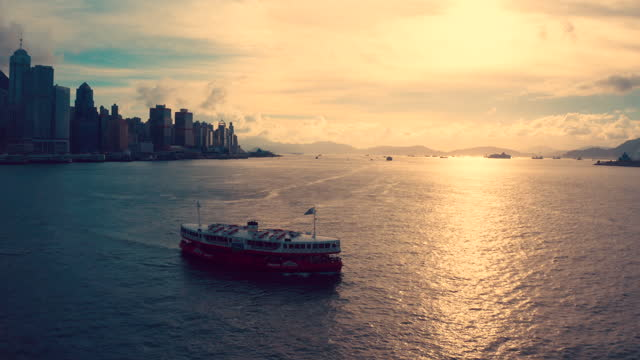 aerial view of hong kong city skyline in hong kong china - star ferry stock videos & royalty-free footage