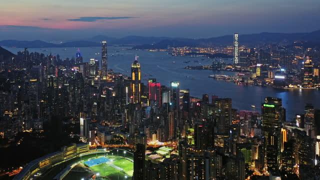 aerial view of hong kong island downtown at dusk - central district hong kong stock videos & royalty-free footage