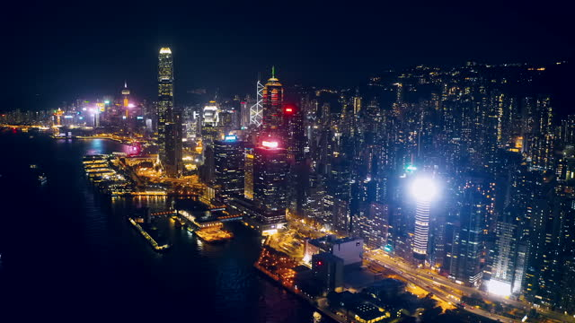 aerial view of hong kong skyline at night, china - hong kong stock videos & royalty-free footage