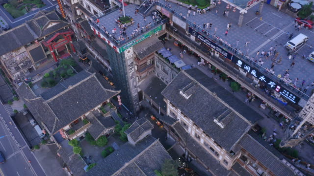 Aerial view of Hongyadong (stilt house against a cliff) and tourists in town square