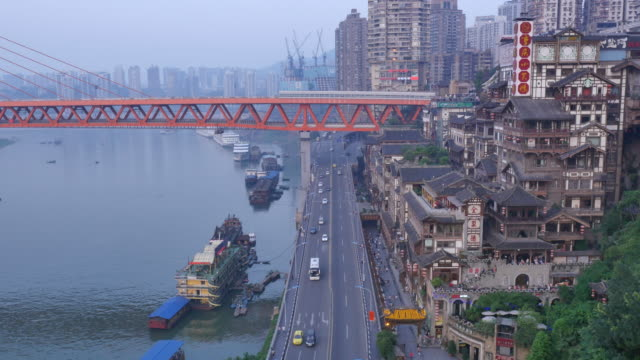 aerial view of hongyadong (stilt house against a cliff) and traffic on the road - stilt house stock videos & royalty-free footage
