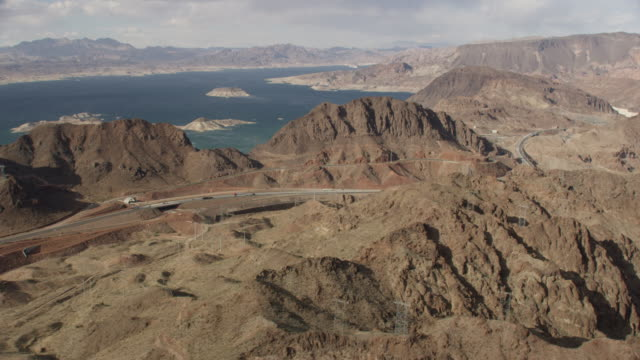 aerial view of hoover dam area and route 93 - ネバダ州クラーク郡点の映像素材/bロール