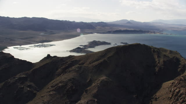 aerial view of hoover dam area, colorado river and mountains - hydroelectric power stock videos and b-roll footage