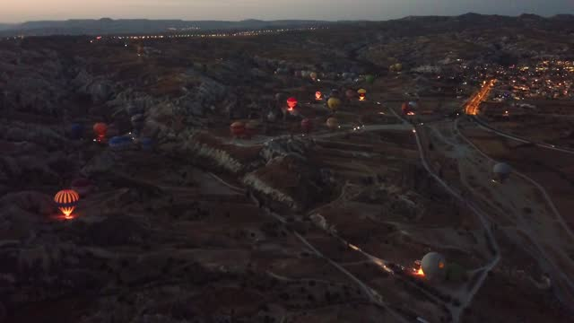 aerial view of hot air balloons in cappadocia at dawn - organisation stock videos & royalty-free footage