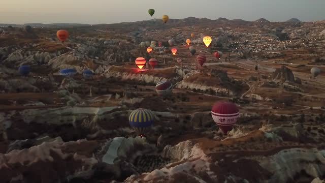 aerial view of hot air balloons in cappadocia at dawn - sunset stock videos & royalty-free footage